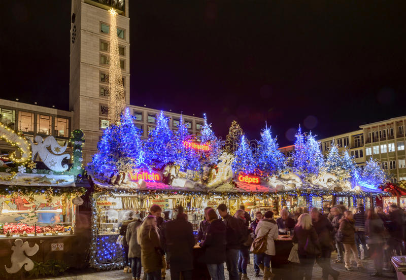 Lightened stall roofs in City Hall square at Xmas market time, S royalty free stock photos