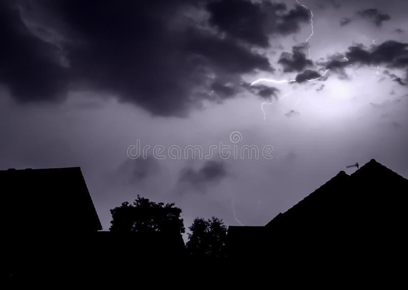 Lightening bolt over houses stock image
