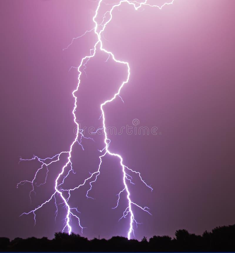 Lightening Bolt. A vivid flash of lightening in the night sky stock photo