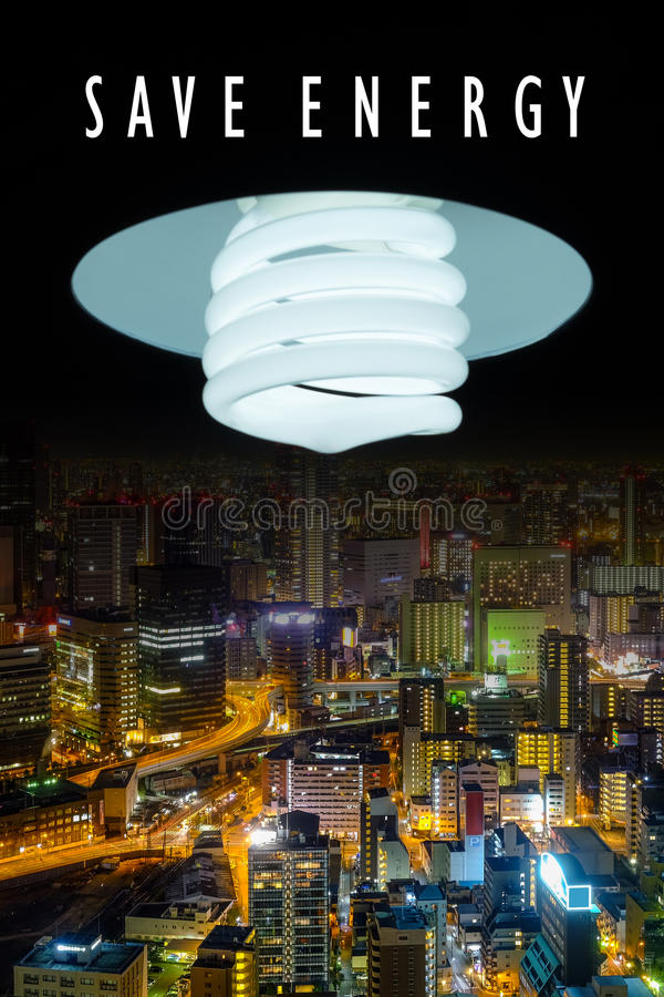 Lightening compact fluorescent shining to the city. Energy saving, cityscape at night stock images