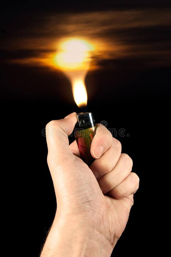Lighter and sunset royalty free stock photo
