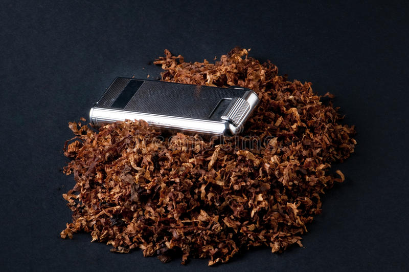 Lighter and tobacco stock image