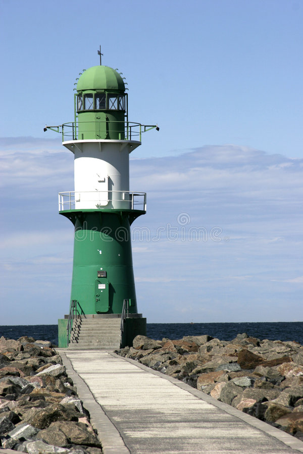 Lighthouse. At the end of a path royalty free stock photography