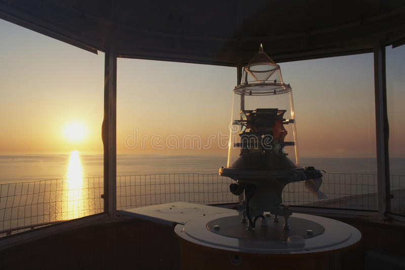Lighthouse. The interior of the lighthouse. Clearly visible warning light. Marine sunset in the background royalty free stock photography