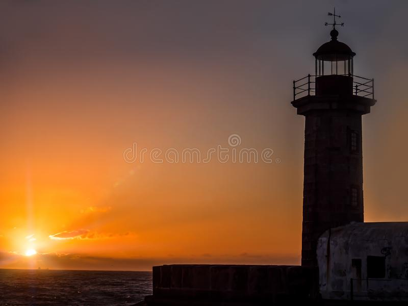 Lighthouse against the sunset, Porto, Portugal royalty free stock photo