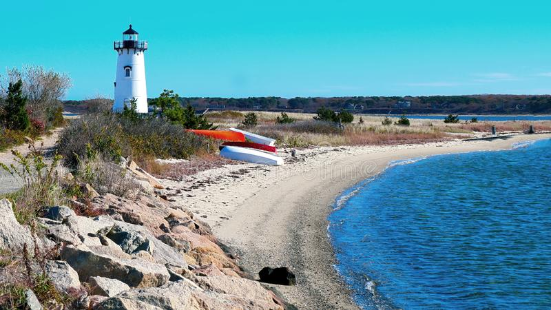 Lighthouse Along the Water in New England. A landscape image of a Lighthouse along the water in Martha`s Vineyard, New England royalty free stock image