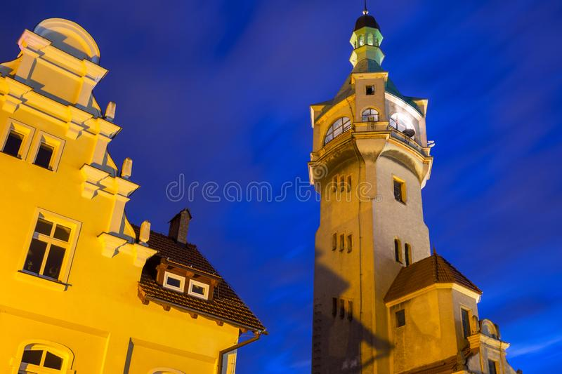 Lighthouse by the Baltic pier in Sopot at dusk, Poland. Molo night tower travel season beach tricity bay vacation polish destination coast seaside european stock image