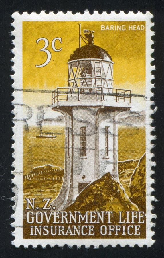 Lighthouse at Baring Head. NEW ZEALAND - CIRCA 1969: stamp printed by New Zealand, shows Lighthouse at Baring Head, circa 1969 royalty free stock photography