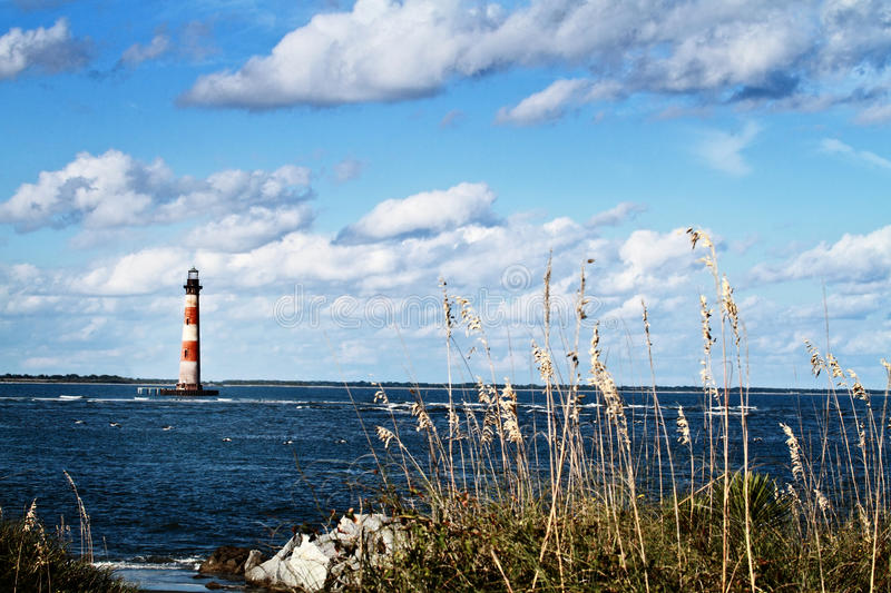 Lighthouse by the Beach royalty free stock photo