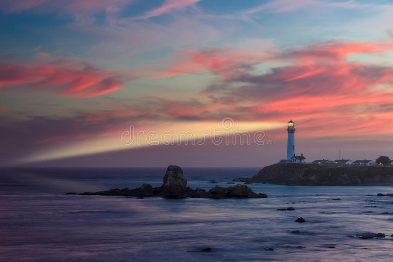 Lighthouse beaming light ray at sunset, Pigeon point Lighthouse royalty free stock photography