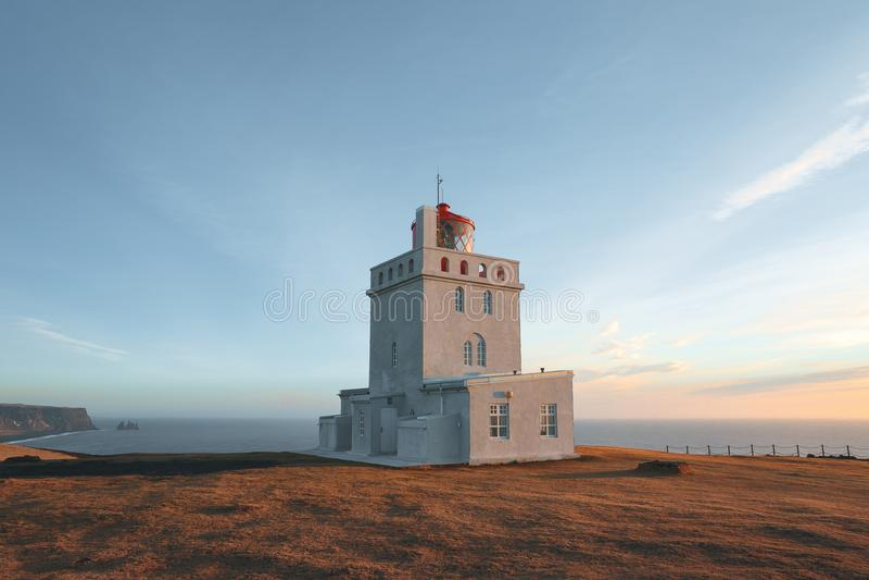 Lighthouse at beautiful icelandic seacoast at sunny day, vik dyrholaey, reynisfjara. Beach, iceland royalty free stock photos