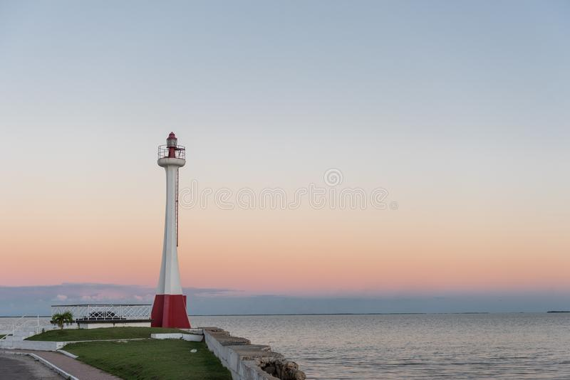 Lighthouse in Belize. Sunset light with Caribbean sea in Background royalty free stock image