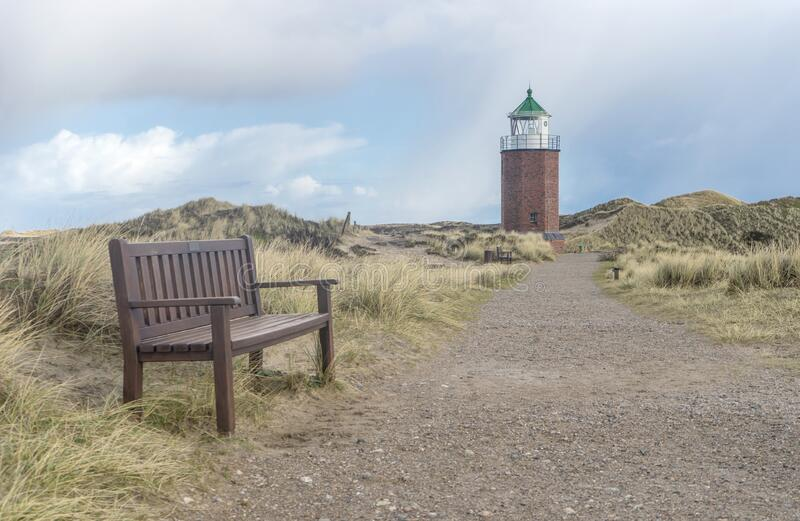 Lighthouse and bench on the Red Reef on the island of Sylt stock image