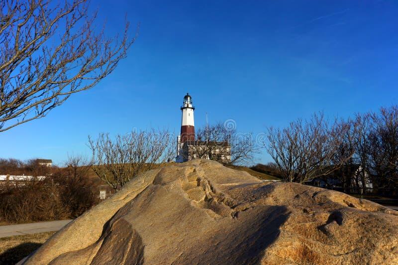 Lighthouse Beyond The Rocks Stock Photography