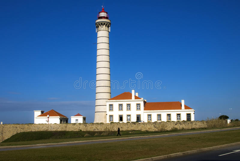 Lighthouse with blue sky as background stock images