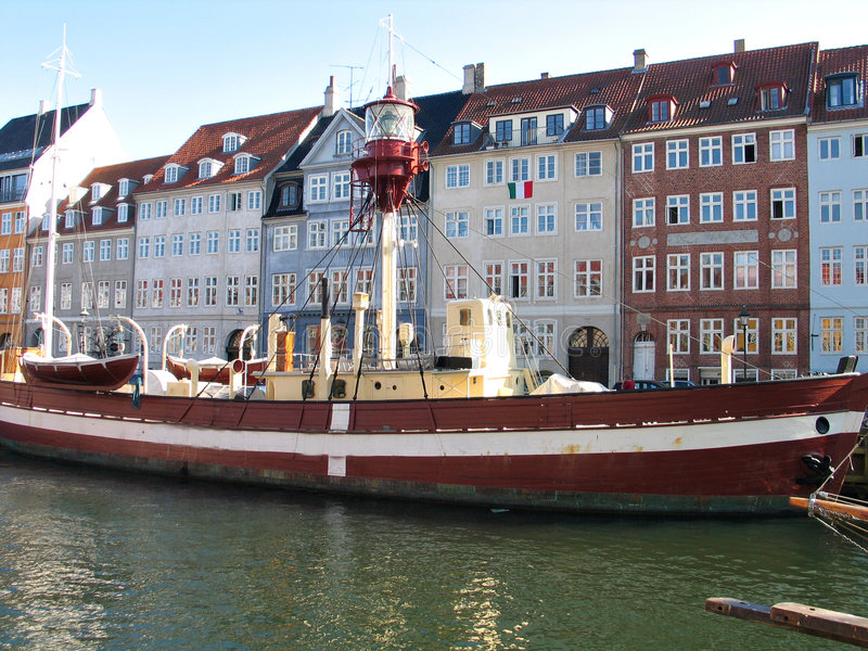 Lighthouse boat in Copenhagen's water canals. Copenhagen water canals with a lighthouse boat stock photos