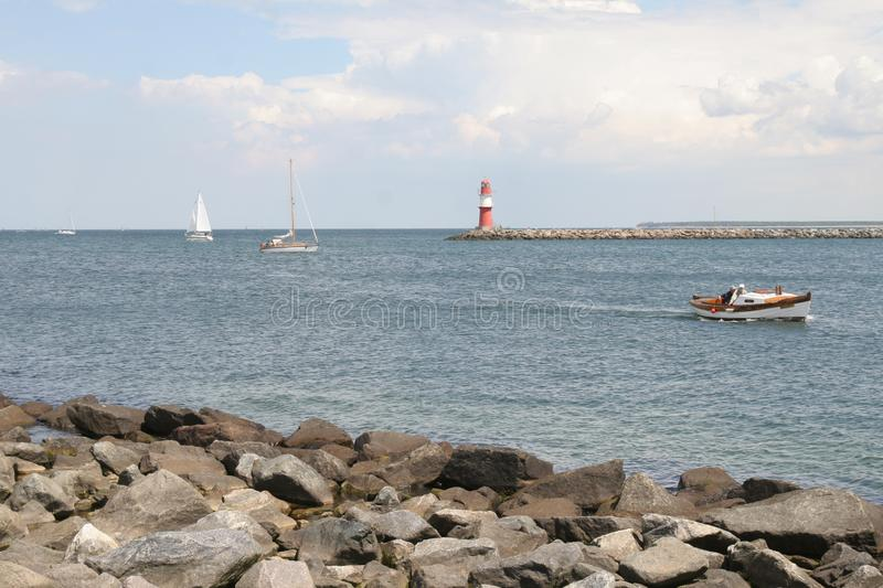 Lighthouse at the coastline, warnemuende, rostock, germany stock images