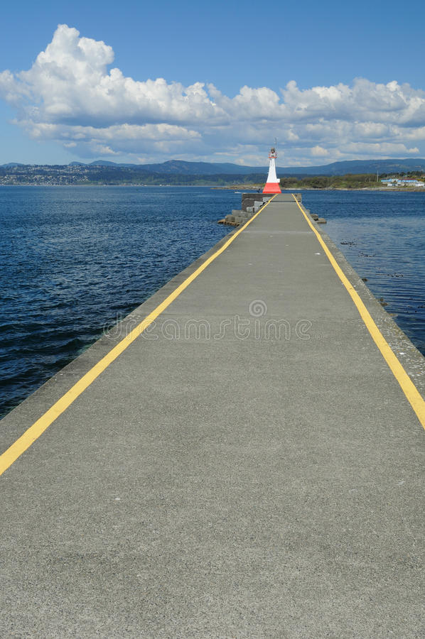 Lighthouse and breakwater royalty free stock image