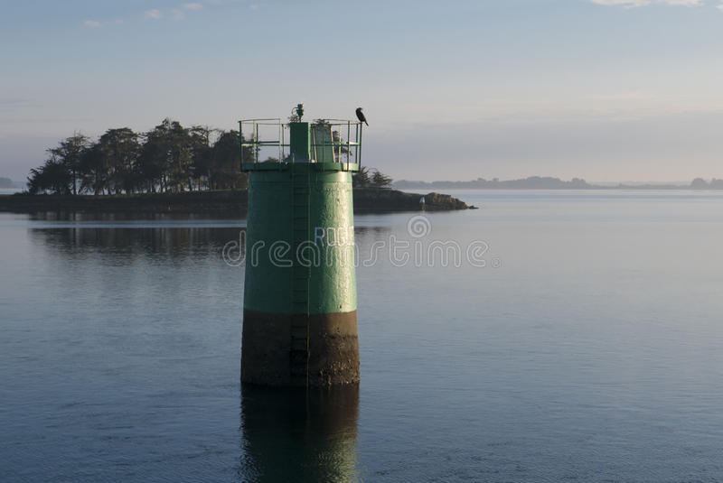 Lighthouse in Brittany Morbihan, France. Lighthouse with bird taken from the Island of Arz in Brittany Morbihan, France royalty free stock images