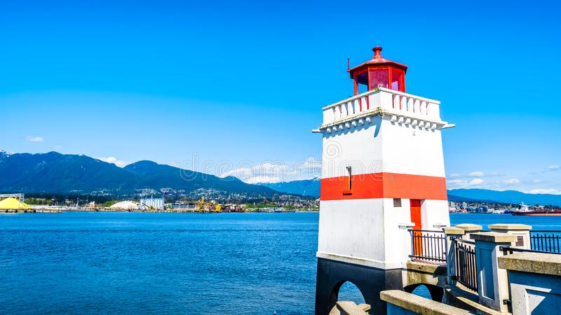 The Lighthouse at Brockton Point on the  Seawall pathway in Vancouver`s Stanley Park. The Lighthouse at Brockton Point on the famous Seawall pathway in Vancouver stock photo