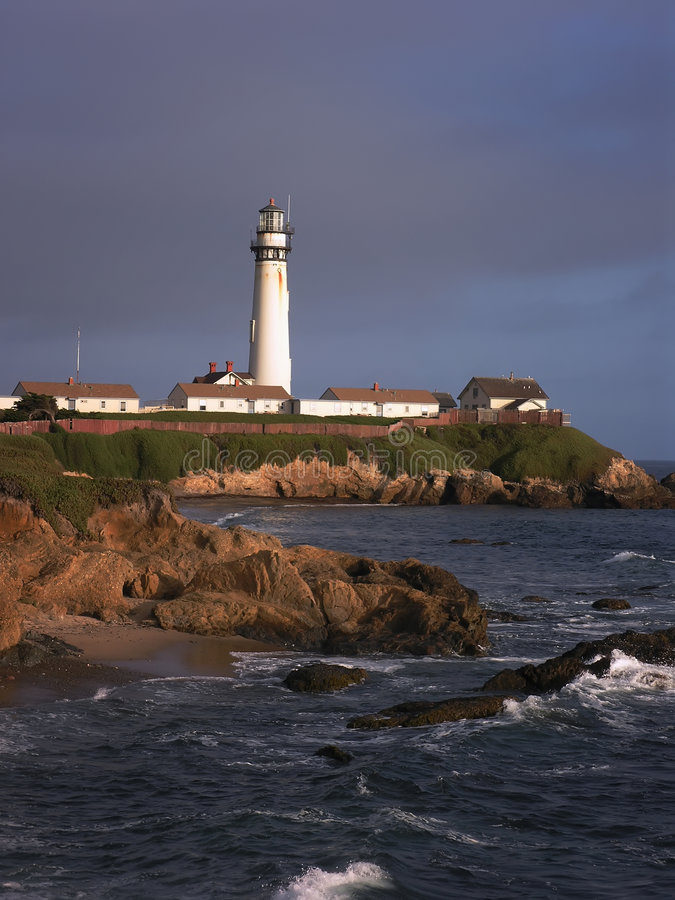 Lighthouse With Buildings stock photography