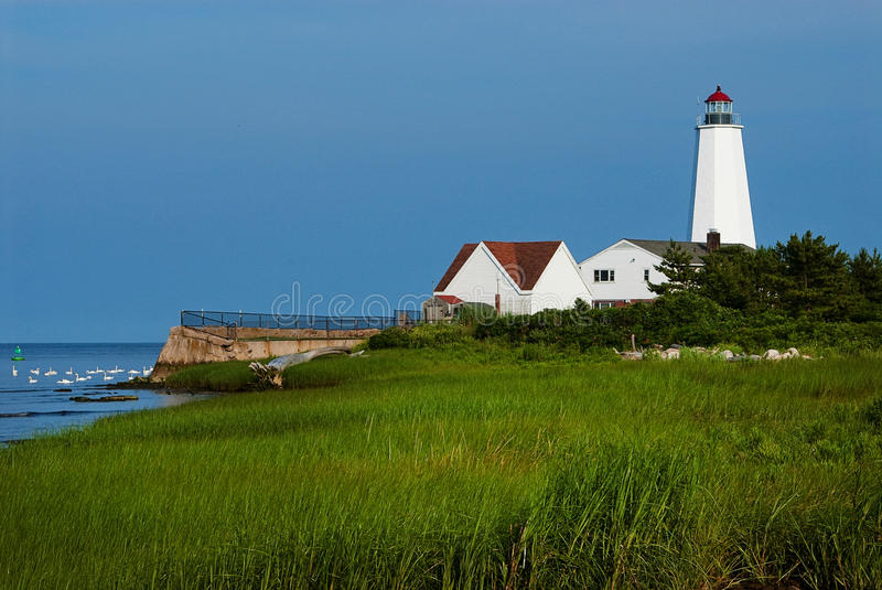 Lighthouse Built On Connecticut Marshland. When Lynde Point lighthouse in Old Saybrook Connecticut was rebuilt, the tower was much higher, and windows were royalty free stock photos