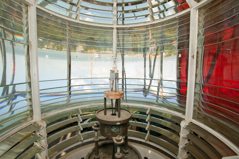 Lighthouse bulb and fresnel optic. Bulb inside lighthouse fresnel lens, grave point, France stock photo