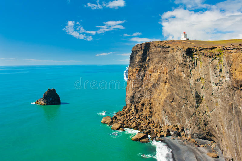 Lighthouse at cape Dyrholaey royalty free stock photography