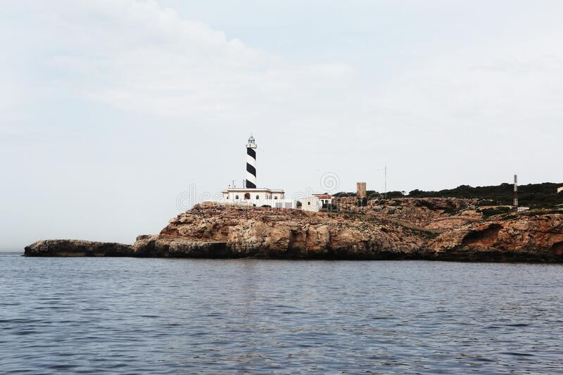 Lighthouse on cape royalty free stock images