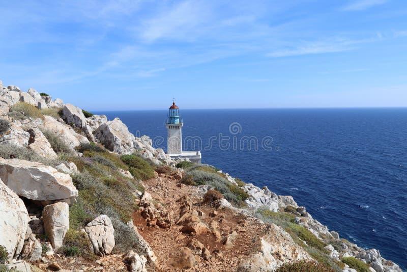 Lighthouse at Cape Tenaro near the entrance to the underworld Greek mythlology. The Lighthouse at Cape Tenaro / Cape Matapan marks the spot where according to royalty free stock images