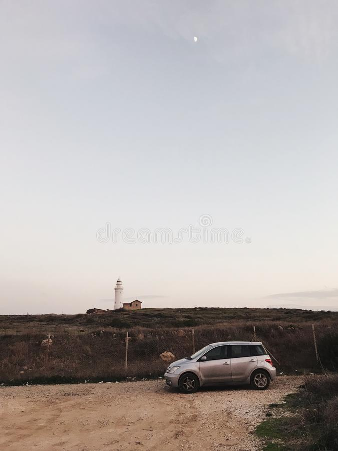 Lighthouse and a car in Cyprus royalty free stock photography