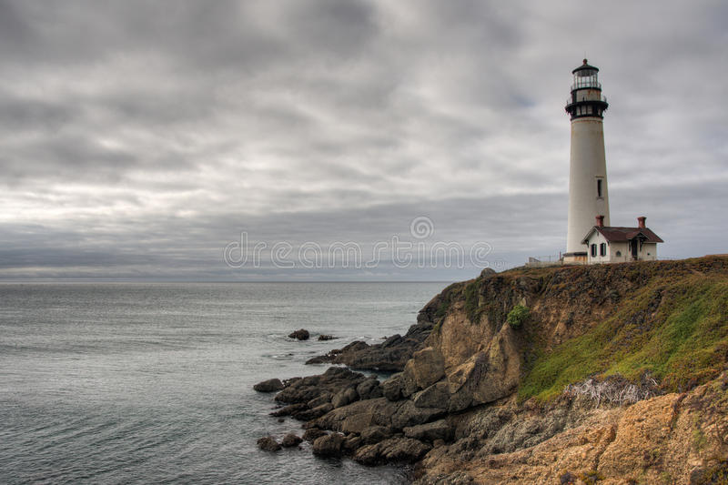 Lighthouse on the cliff stock photo