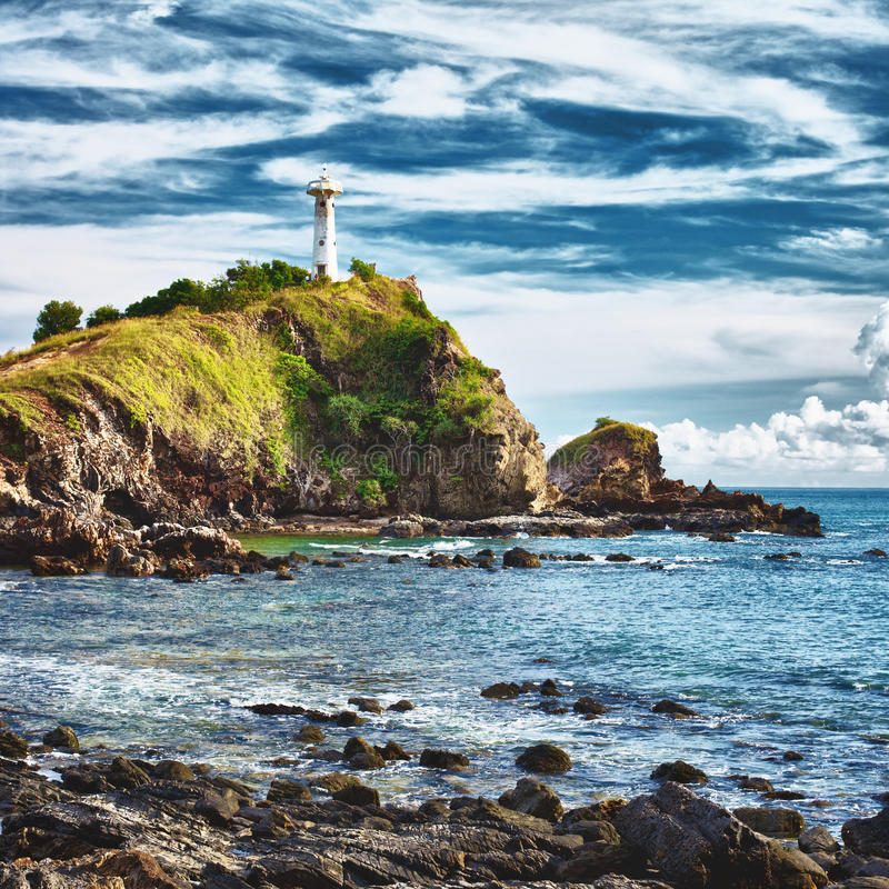 Lighthouse on a Cliff stock photo  Image of dramatic - 24131348