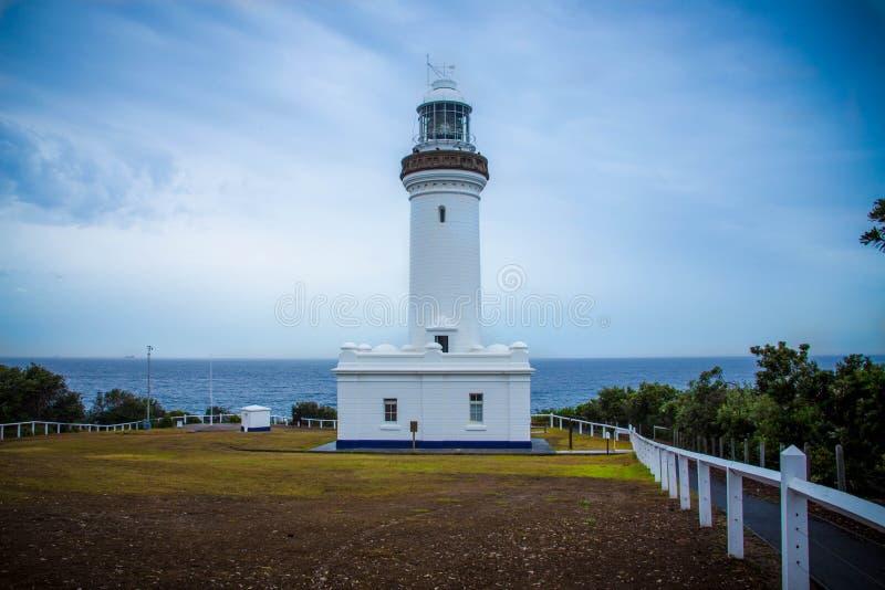 Lighthouse on a cloudy day stock photos