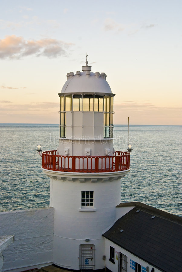 Lighthouse in the coast of Wicklow, Ireland. royalty free stock photos