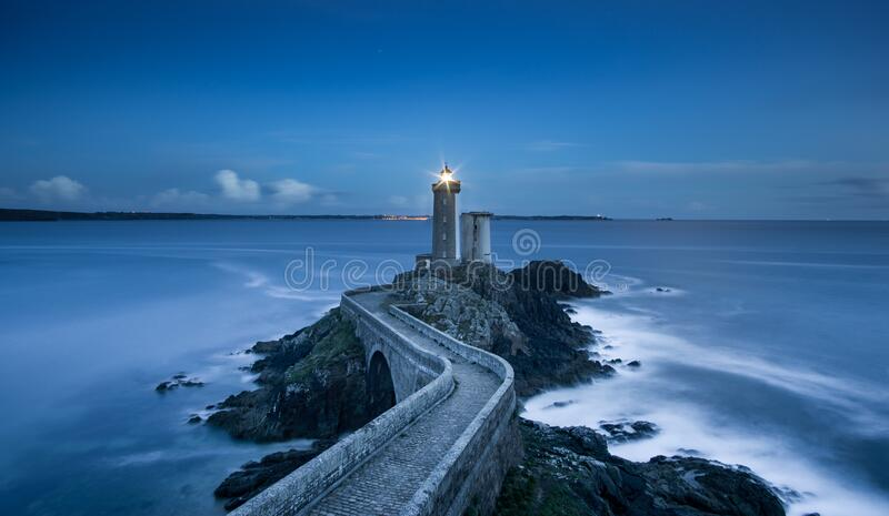 Lighthouse on coastline royalty free stock photography