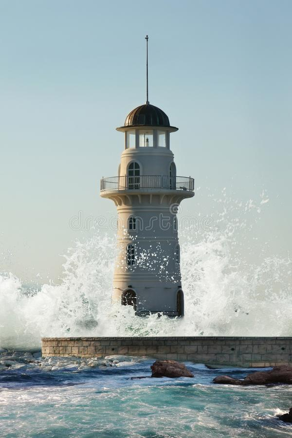 Lighthouse and wave royalty free stock image