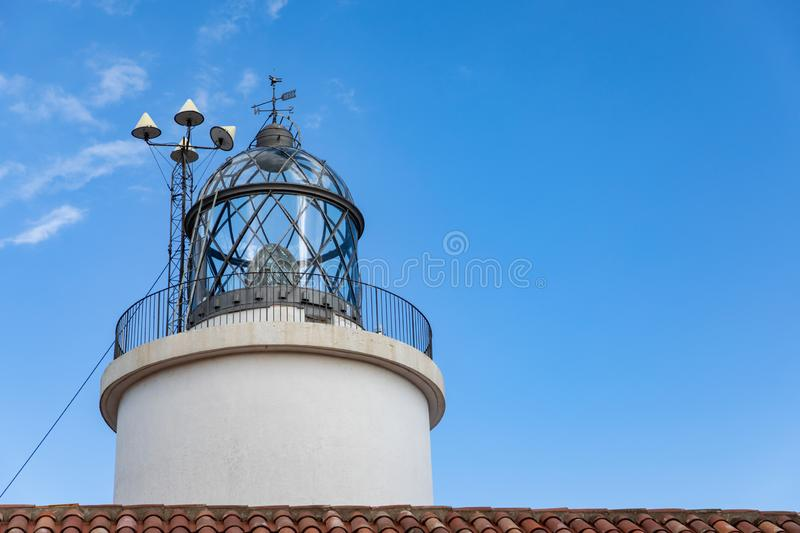 Lighthouse during day time with clear sky. With copy space stock images