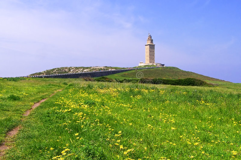 Download Lighthouse At The Distance In A Green Field Stock Images - Image: 178584