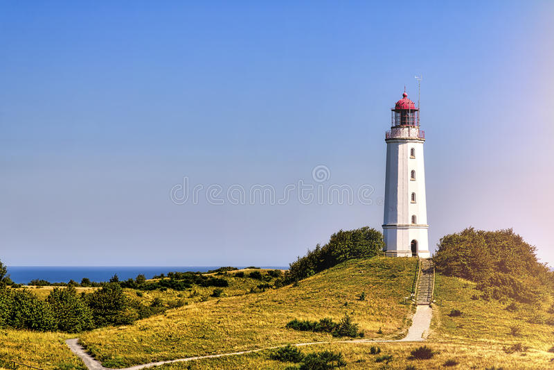 Lighthouse Dornbusch at Hiddensee island. Landscape and lighthouse Dornbusch at Hiddensee island royalty free stock photo
