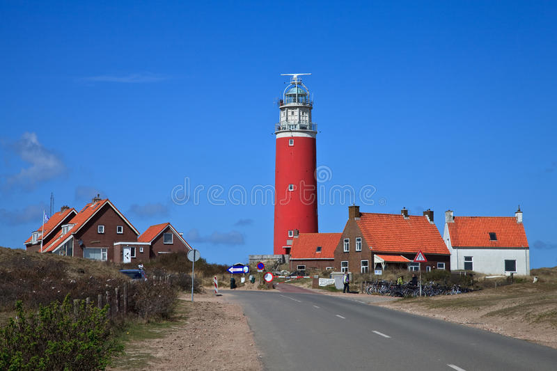 Lighthouse in the dunes at the beach stock photo