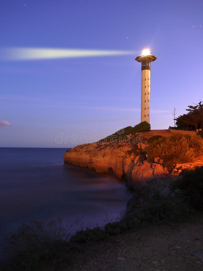 Lighthouse at dusk stock images
