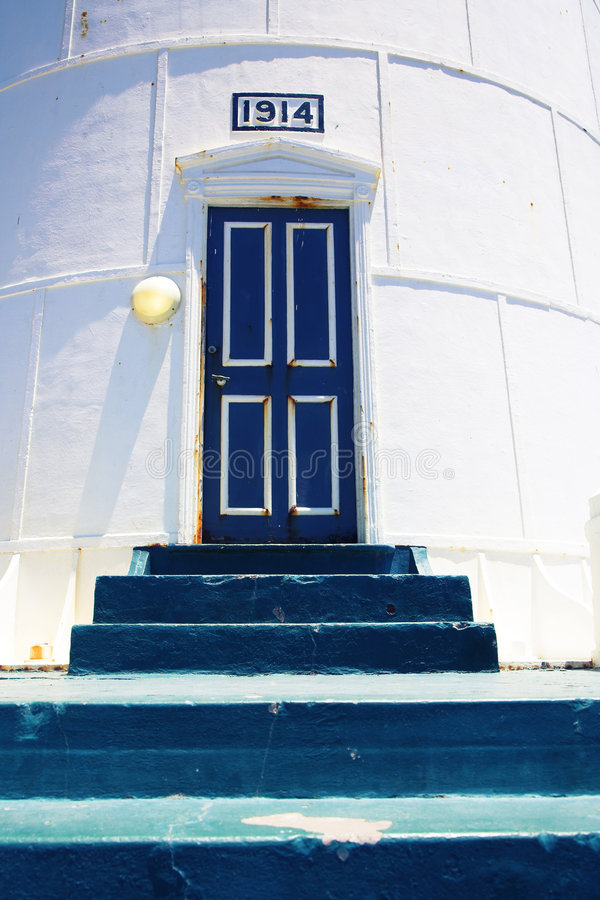 Lighthouse entrance with old steps. Historical Light House on Atlantic Ocean in South Africa royalty free stock images