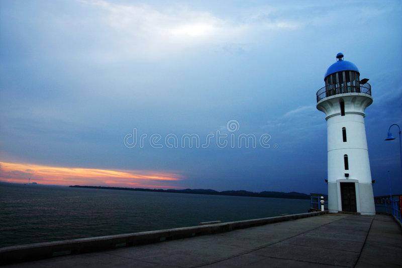 Lighthouse at evening sunset royalty free stock photography