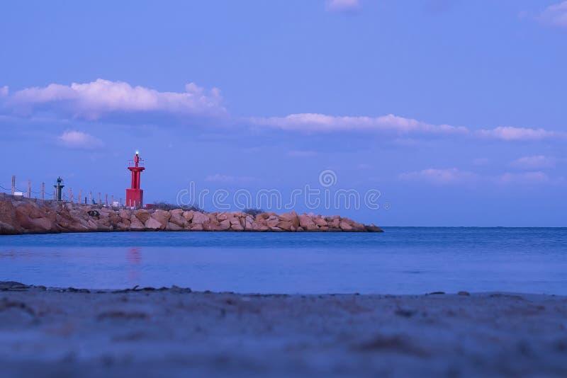 Lighthouse, evening twilight. Landscape with sea. Nature. Lighthouse, evening twilight. Landscape with sea royalty free stock photos