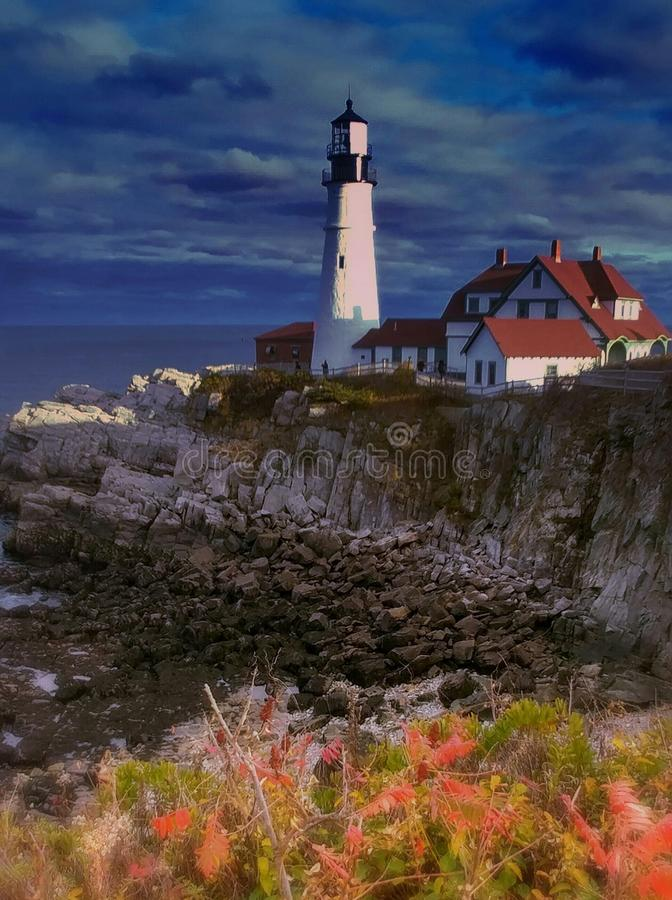 Lighthouse in the fall royalty free stock image