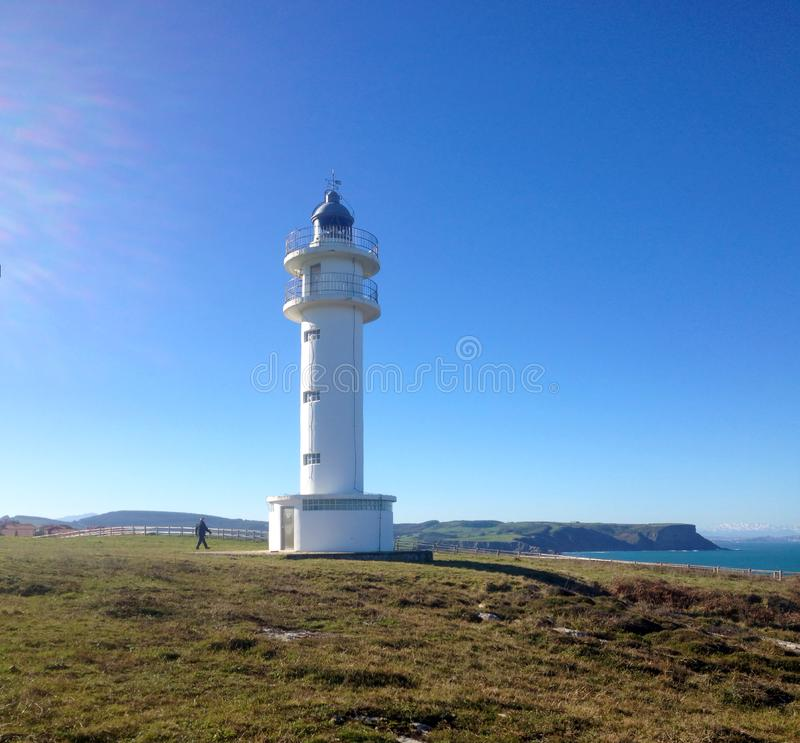 Lighthouse Faro de cabo Ajo, Bareyo, Cantabria, Northern Spain. royalty free stock photo