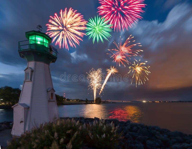 Lighthouse fireworks royalty free stock photos