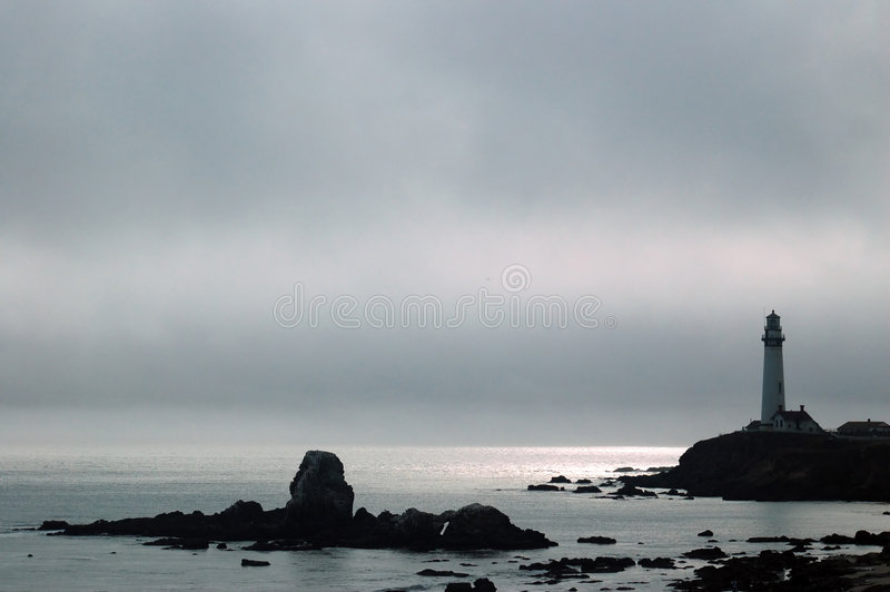 Lighthouse on a Foggy afternoon stock photography