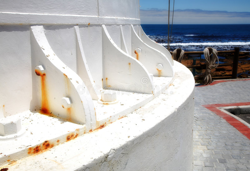 Lighthouse foundation with rust marks. Foundation Detail of Historical Light House on Atlantic Ocean in South Africa stock photos